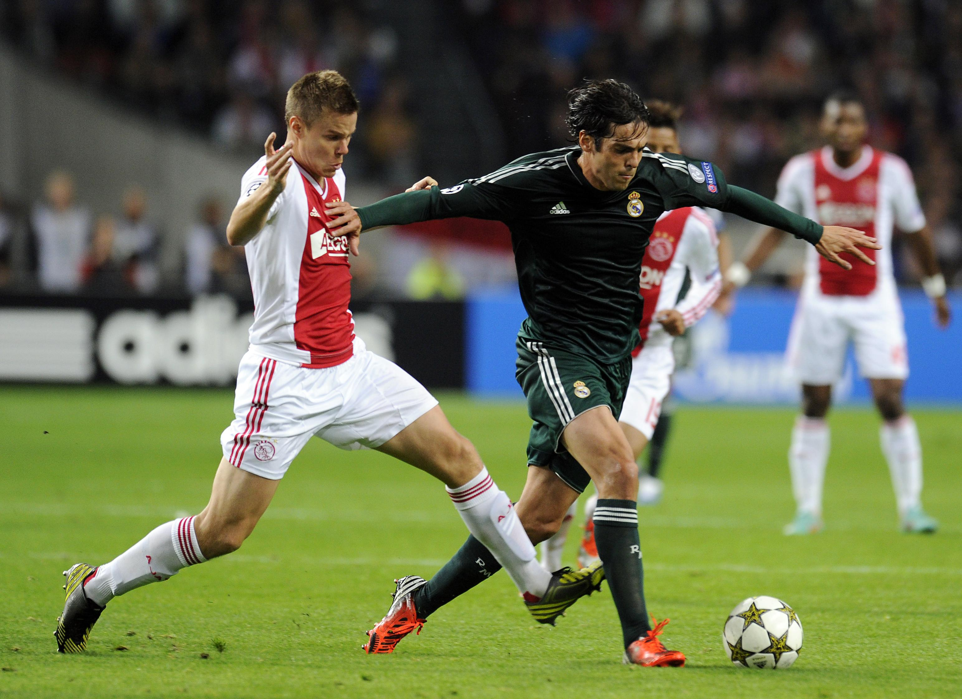 Ajax Amsterdam's Niklas Moisander Fights For The Ball With