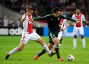 Ajax Amsterdam's Niklas Moisander fights for the ball with Real Madrid's Kaka during their Champions League Group D soccer match at the Amsterdam Arena stadium