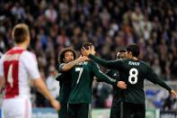 Real Madrid's Cristiano Ronaldo celebrates his goal with teammates during their Champions League Group D soccer match against Ajax Amsterdam at the Amsterdam Arena stadium